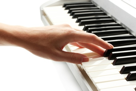 hand of woman playing synthesizer photo