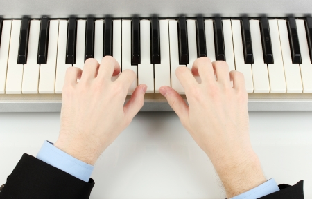 hands of man playing piano Stock Photo - 14368741