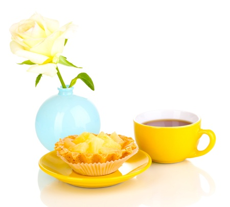 sweet cake with cup of tea isolated on white photo