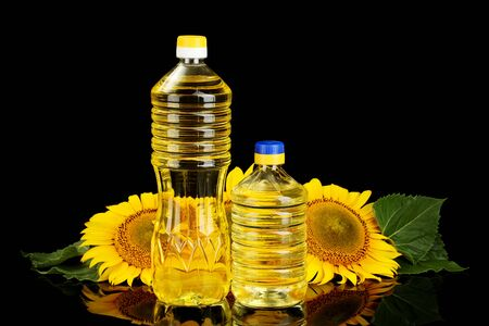 sunflowerseed: sunflower oil and sunflower isolated on black Stock Photo