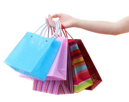 Female hand holding bright shopping bags isolated on white Stock Photo - 14366683