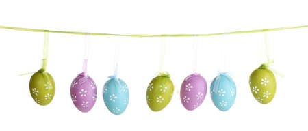 Colorful easter eggs hanging on ribbons isolated on white Stock Photo - 14354663