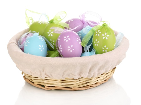 Colorful easter eggs in basket isolated on white Stock Photo - 14354893