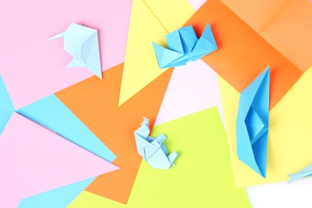 blue origami on bright paper background photo