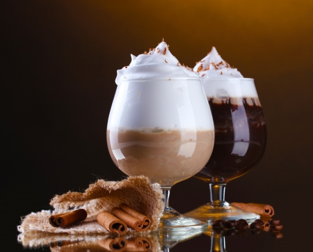 cafe latte: glasses of coffee cocktail on brown background