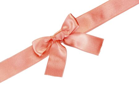 beautiful orange satin bow and ribbon isolated on white  photo