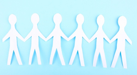 Paper people on blue background Stock Photo - 14354873