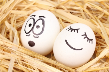 embarrassment: White eggs with funny faces in straw