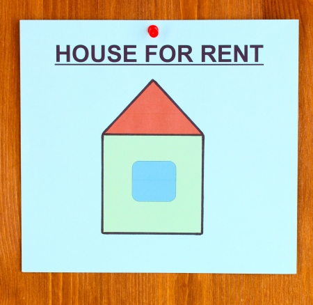 poster about renting the house on wooden background photo