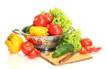 fresh vegetables and knife on cutting board isolated on white Stock Photo - 14427176