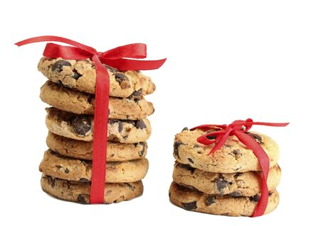 Chocolate chips cookies with red ribbons isolated on white  Stock Photo - 14437147