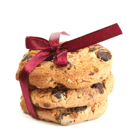 homemade cookies: Chocolate chips cookies with red ribbon isolated on white