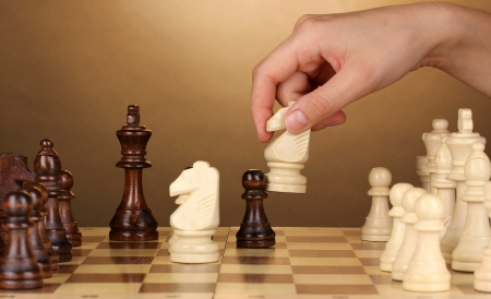 Chess board with chess pieces on brown background Stock Photo - 14454133