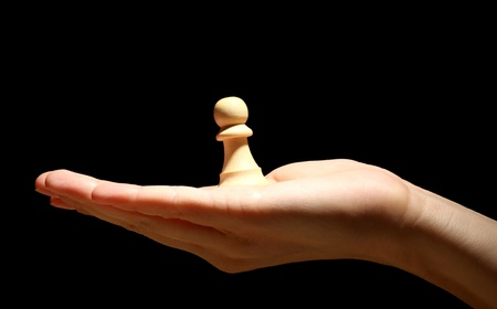 Chess piece in hand isolated on black Stock Photo - 14436234