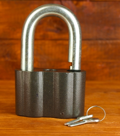 old padlock with keys on wooden background close-up Stock Photo - 14453729