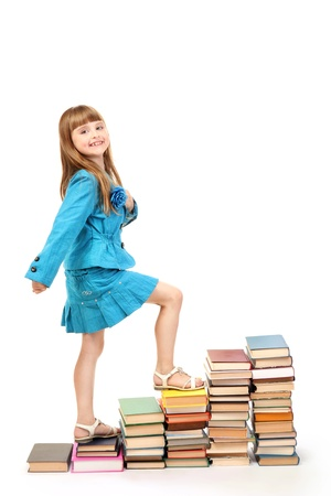 achiever: little girl with a books isolated on white