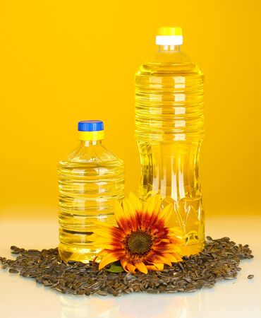 sunflower oil in a plastic bottles on yellow background photo