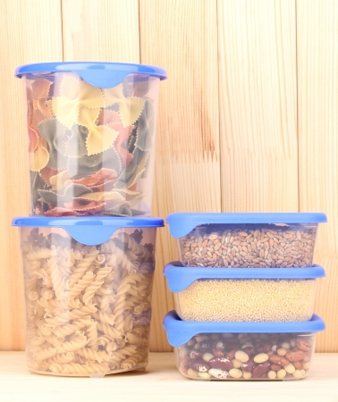 Filled plastic containers on wooden background photo