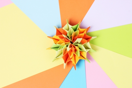 Colorfull origami on bright paper background photo