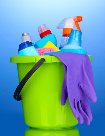 cleaning products: Bucket with cleaning items on blue background