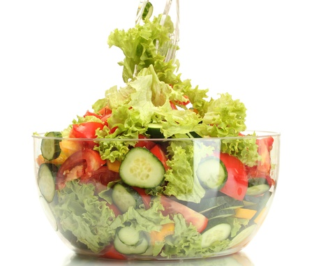 paprica: fresh vegetable salad in transparent bowl with spoon and fork isolated on white