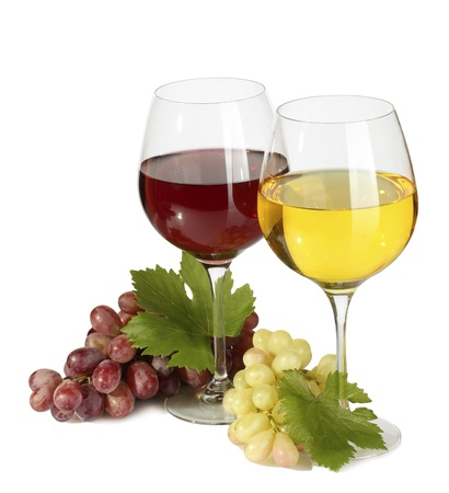 grape harvest: glasses of wine and ripe grapes isolated on white