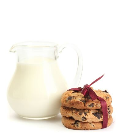 jar of milk and chocolate chips cookies with red ribbon isolated on white  photo