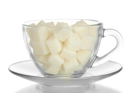 refined sugar in glass cup isolated on white background photo