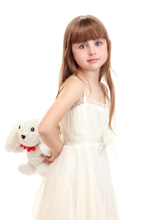 Portrait of beautiful cute girl with toy rabbit isolated on white photo