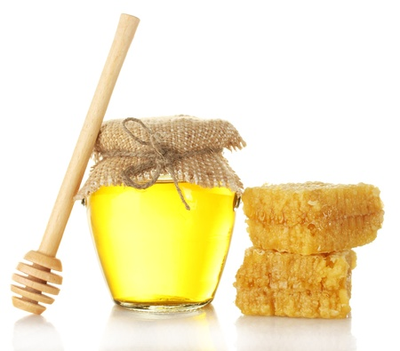 Sweet honey in jar with wooden drizzler and honeycomb isolated on white photo