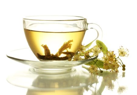linden tea: cup of linden tea and flowers isolated on white