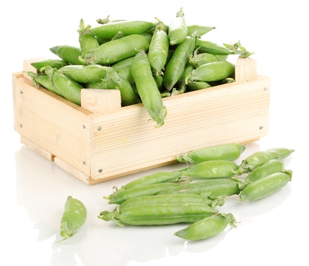 Green peas in crate isolated on white photo