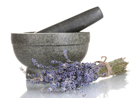 Lavender flowers with mortar and candles isolated on white photo