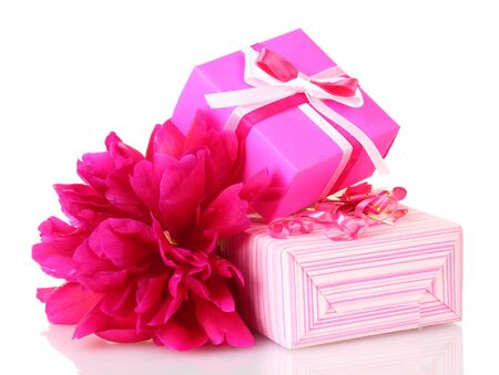 beautirul pink gifts and peony flower isolated on white
