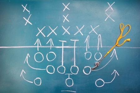 tactic: American football plan on blackboard