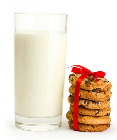 glass of milk and chocolate chips cookies with red ribbon isolated on white  photo