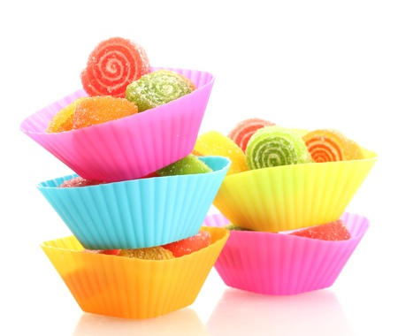 sweet jelly candies in cup cake cases isolated on white  photo