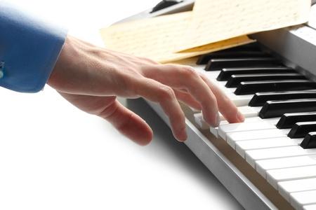 hand of man playing piano photo