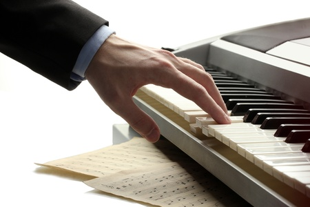 hand of man playing piano photo