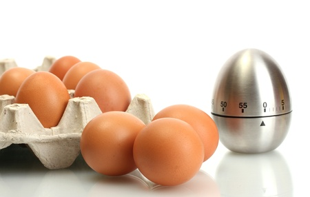 eggs in box and egg timer isolated on white Stock Photo - 14518629