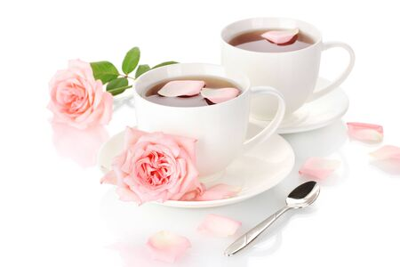 cups of tea with roses isolated on white photo