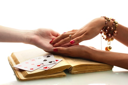 astrologist: reading the lines hand in a womans hands isolated on white