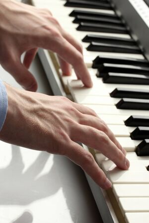 hands of man playing piano Stock Photo - 14531734