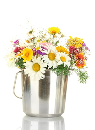 beautiful bouquet of bright  wildflowers in metal bucket,  isolated on white photo