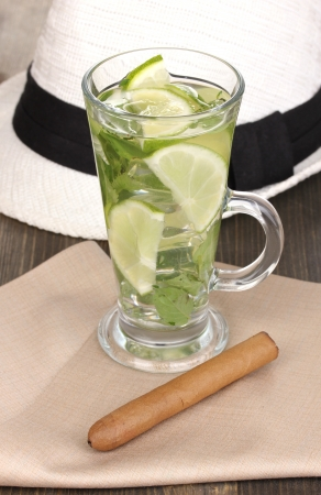 Mojito and a hat on a gray wooden background photo