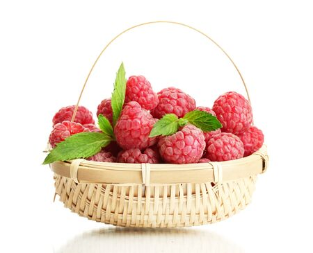 ripe raspberries in basket with mint  isolated on white Stock Photo - 14539609
