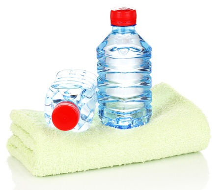 plastic bottles of water on towel isolated on white photo