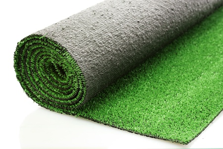 carpet flooring: artificial rolled green grass, isolated on white