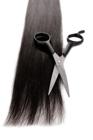 Shiny brown hair and hair cutting shears isolated on white Stock Photo - 14539641