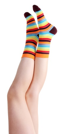 stocking feet: female legs in colorful striped socks isolated on white Stock Photo